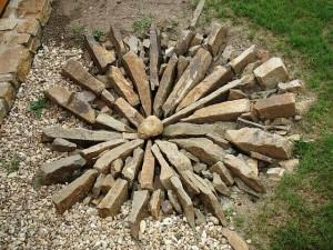 Zahradní ostrůvky s kamenem